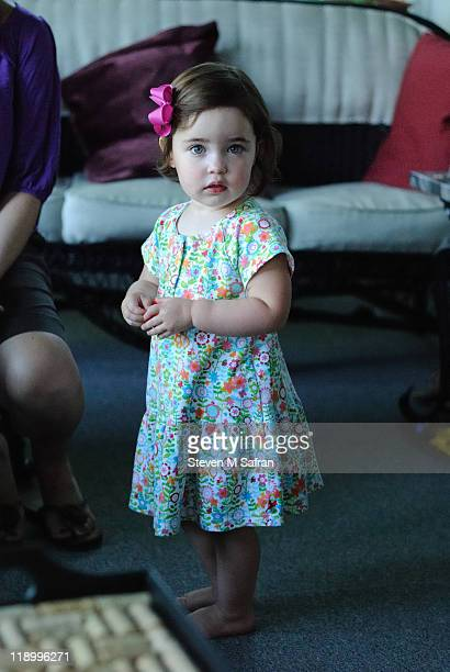 Young girl in floral dress with pink bow