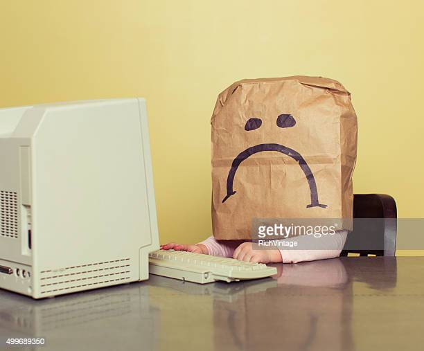 young girl in front of computer with brown bag frown - failure bildbanksfoton och bilder