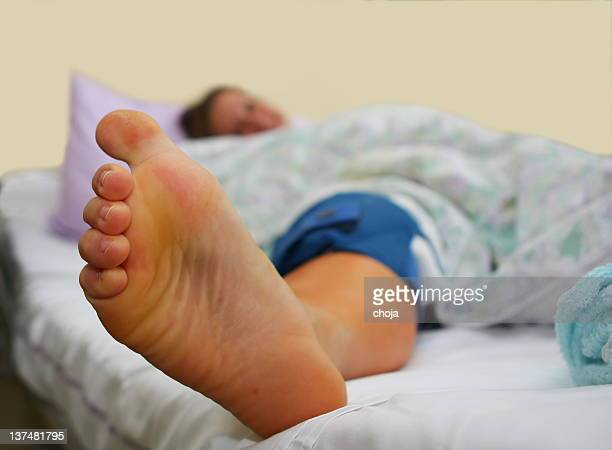 young girl in hospital after knee operation - female feet soles stock photos and pictures