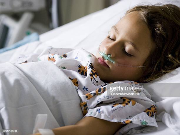 Young girl in hospital bed with respirator