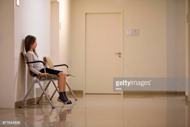 Young girl in hospital waiting room