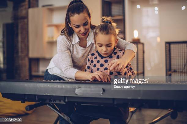 young girl in piano school - keyboard player stock photos and pictures