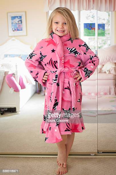 Young girl in pink bathrobe posing