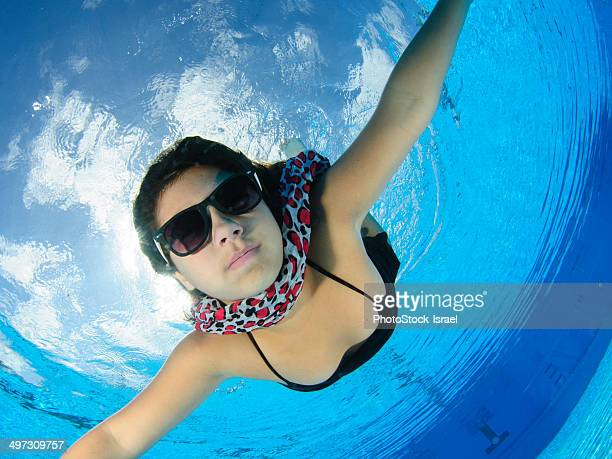 young girl in pool - bottomless girls stock photos and pictures