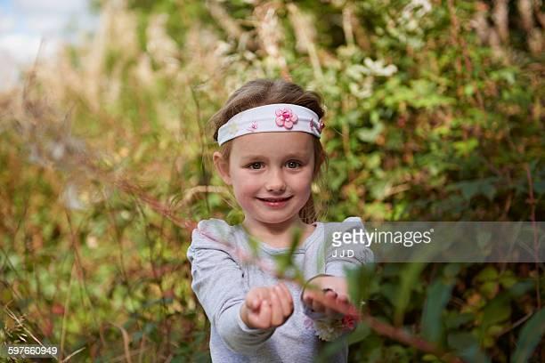 Young girl in rural setting, exploring