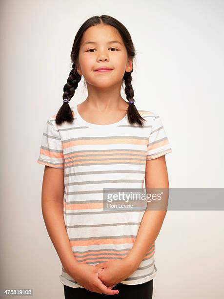 young girl in striped shirt and braids, portrait - three quarter length stock pictures, royalty-free photos & images