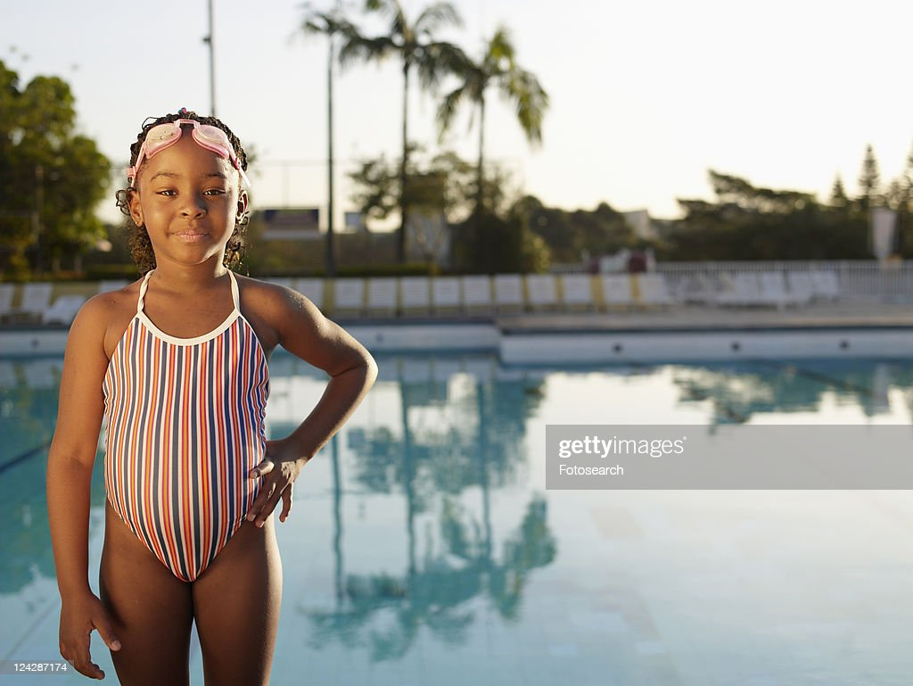 Young Girl In Swimming Costume Standing By Pool Photo Getty Images