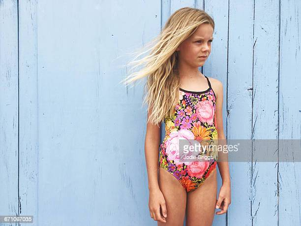 young girl in swimwear down at the beach - one piece swimsuit stock pictures, royalty-free photos & images