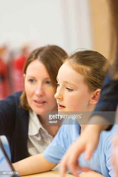 Young Girl In The Classroom With a Computer
