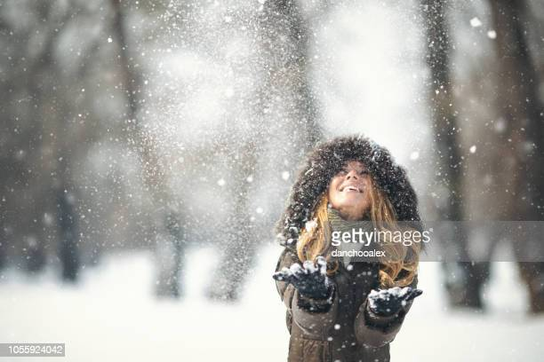 Young girl in the snow enjoying winter time