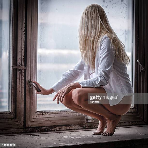 young girl in the window