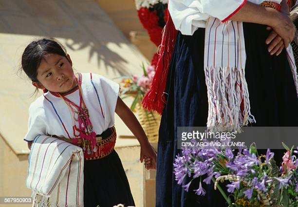 Young girl in traditional costume during the celebrations at the Guelaguetza festival Oaxaca Mexico