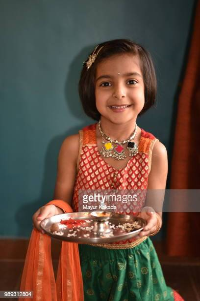 young girl in traditional indian attire holding pooja thali - tradition stock pictures, royalty-free photos & images