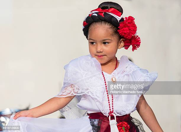 SQUARE TORONTO ONTARIO CANADA Young girl in white dress performing the Flamenco folk dance on stage at MexFest 2015 in Toronto MexFest 2015 is...