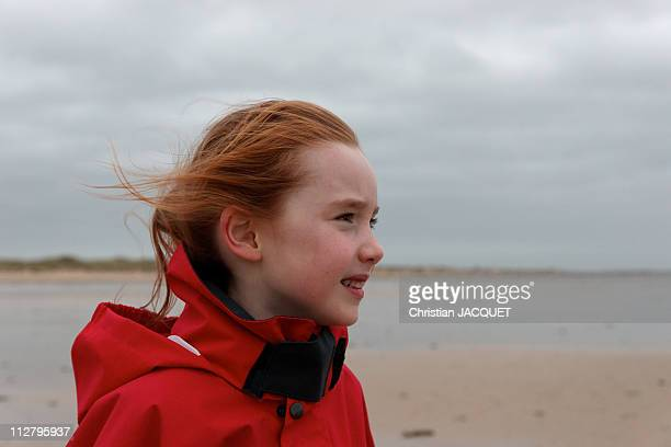Young girl in wind on beach