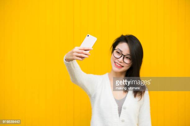 young girl indoors self-timer - far east stock photos and pictures