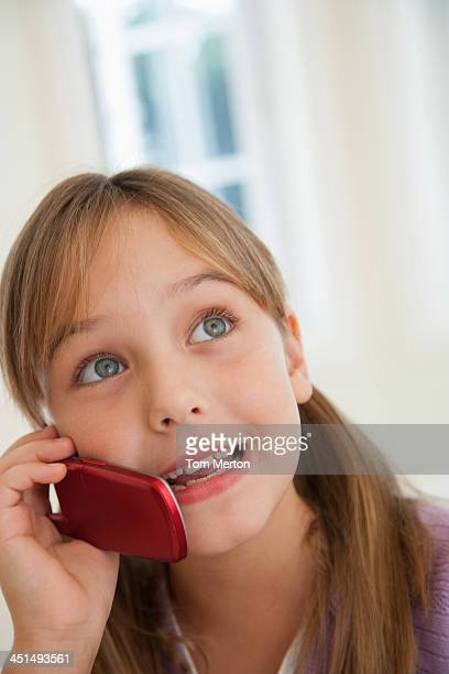 Young girl indoors with cellular phone