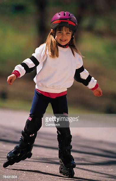 Young girl inline skating