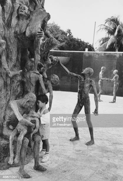 A young girl inspects the sculpture in the 'Garden of Meditation' at the Holocaust Memorial Miami Beach United States 1994