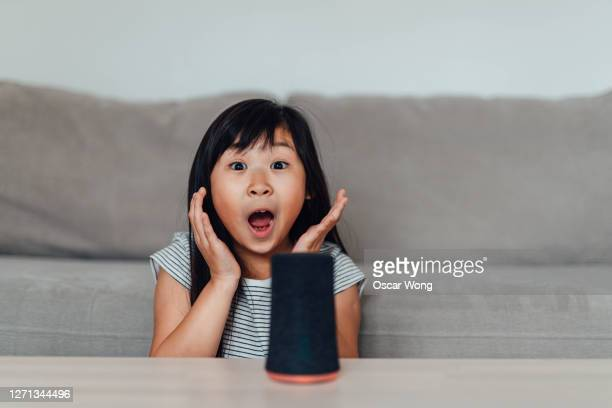young girl is amazed by smart technology - mouth open stock pictures, royalty-free photos & images