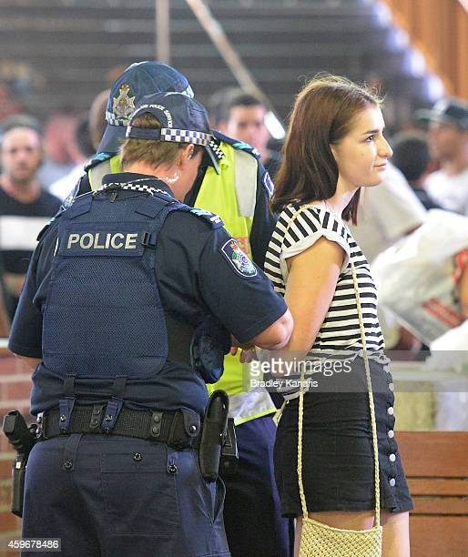 A young girl is arrested by Police during Australian 'schoolies' celebrations following the end of the year 12 exams on November 28 2014 in Gold...