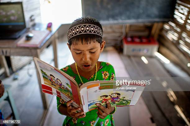 A young girl is asked to read to the other students at the front of the classroom on the floating boat school Shidhulai Swanirvar Sangstha has...