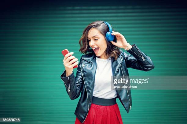 Young girl is dancing and listening the music