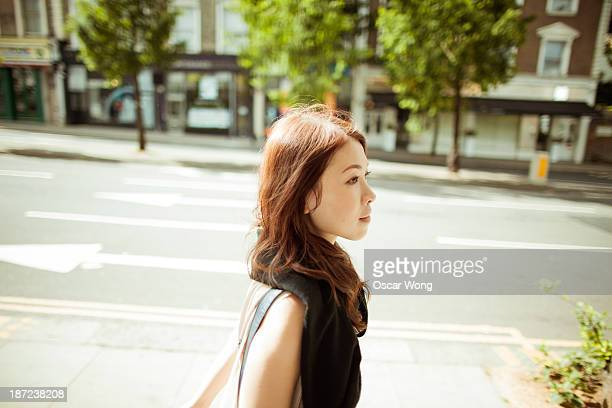 A young girl is getting around the city