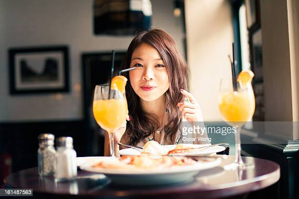 A young girl is having brunch