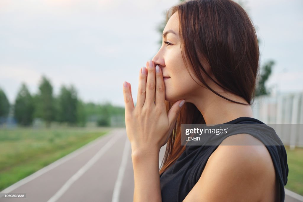 Young girl is holding hands together like praying : Stock Photo