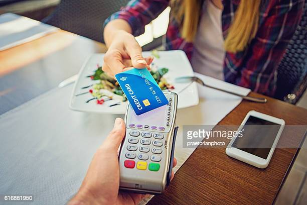 Young girl is paying using her credit card