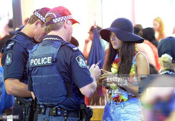 A young girl is questioned by Police during Australian 'schoolies' celebrations following the end of the year 12 exams on November 28 2014 in Gold...