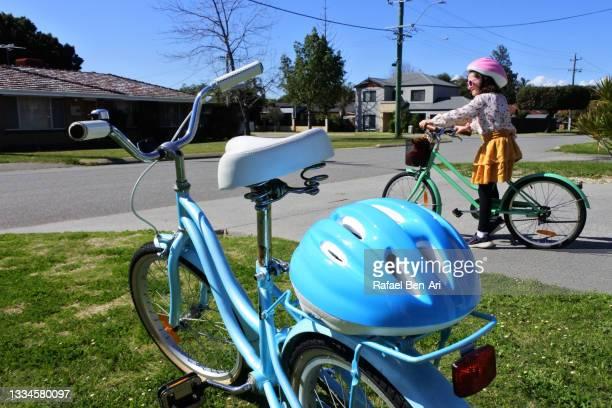 young girl is ready to go on a family bike ride - rafael ben ari fotografías e imágenes de stock