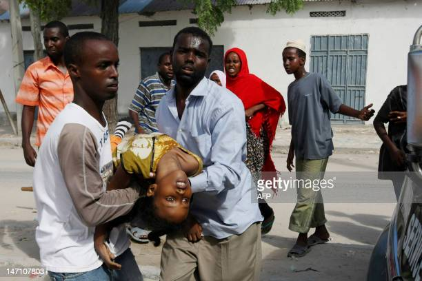 A young girl is rushed to a waiting ambulance and was later pronounced dead after arriving at Medina Hospital in Mogadishu Somalia on May 10 2009 A...
