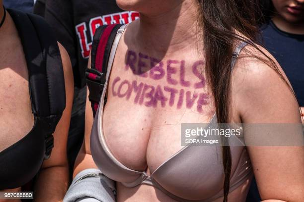 A young girl is seen in bra with her chest painted with the text Rebels and combatives Under the slogan it's not abuse it's rape more than 5000 high...