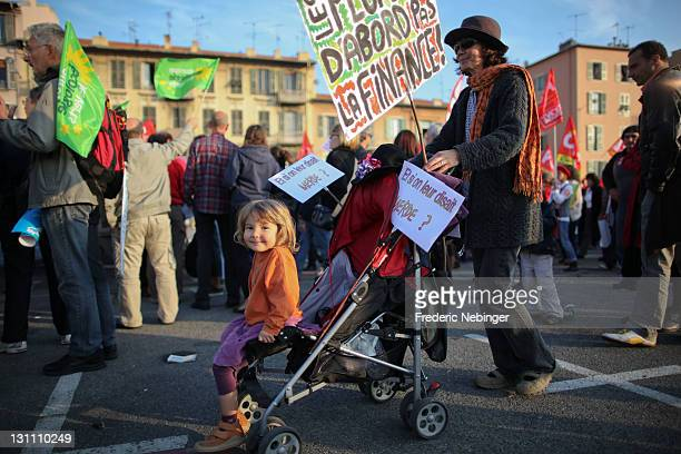 A young girl is seen in her pram during an antiG20 demonstration through the streets of Nice on November 1 2011 in Nice France AntiG20 protesters are...