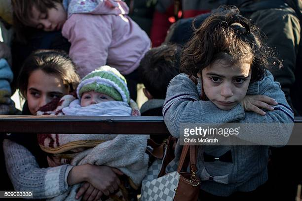 A young girl is seen waiting in line to pass through a border gate as a small number of Syrian refugees were allowed to return to Syria at the closed...