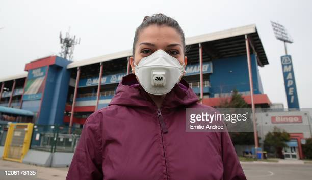 Young girl is seen with the protective mask outside the empty stadium, fans cannot attend the match due to the medical emergency Covid-19 , prior to...