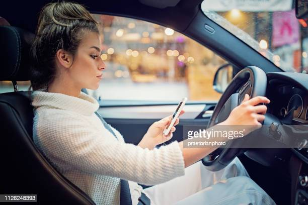 Young girl is texting in the traffic jam
