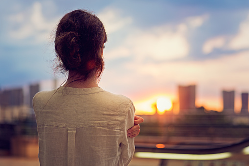 Young girl is watching sunset over Tokyo - gettyimageskorea