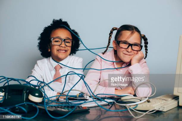 young girl it professionals are fixing computer problems - funny customer service stock pictures, royalty-free photos & images