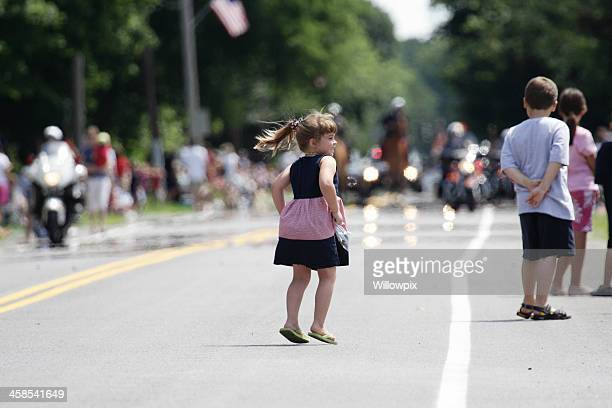 Young Girl Jumping for Joy at the July 4th Parade