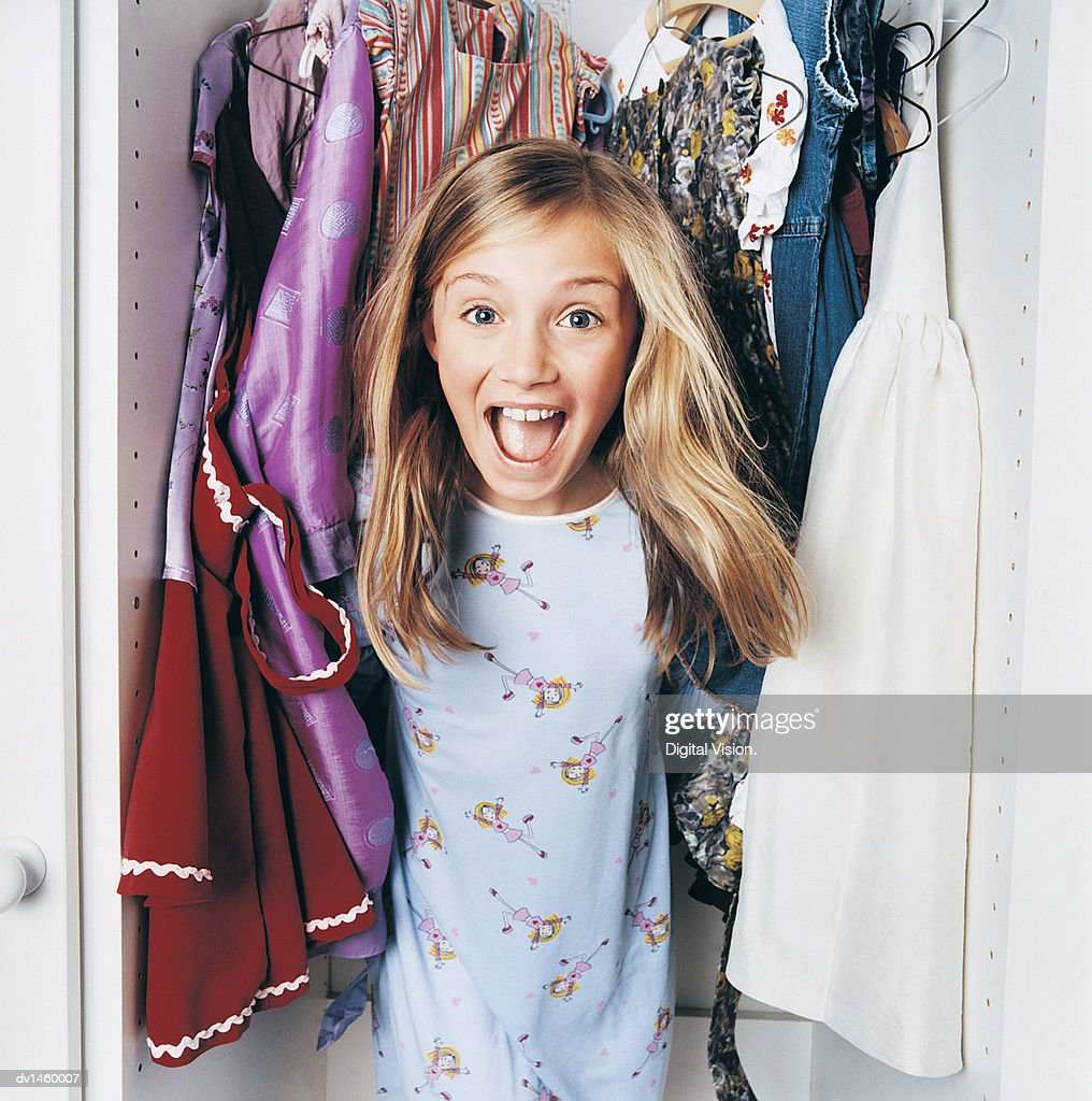 Young Girl Jumping out of a Wardrobe : Stock Photo