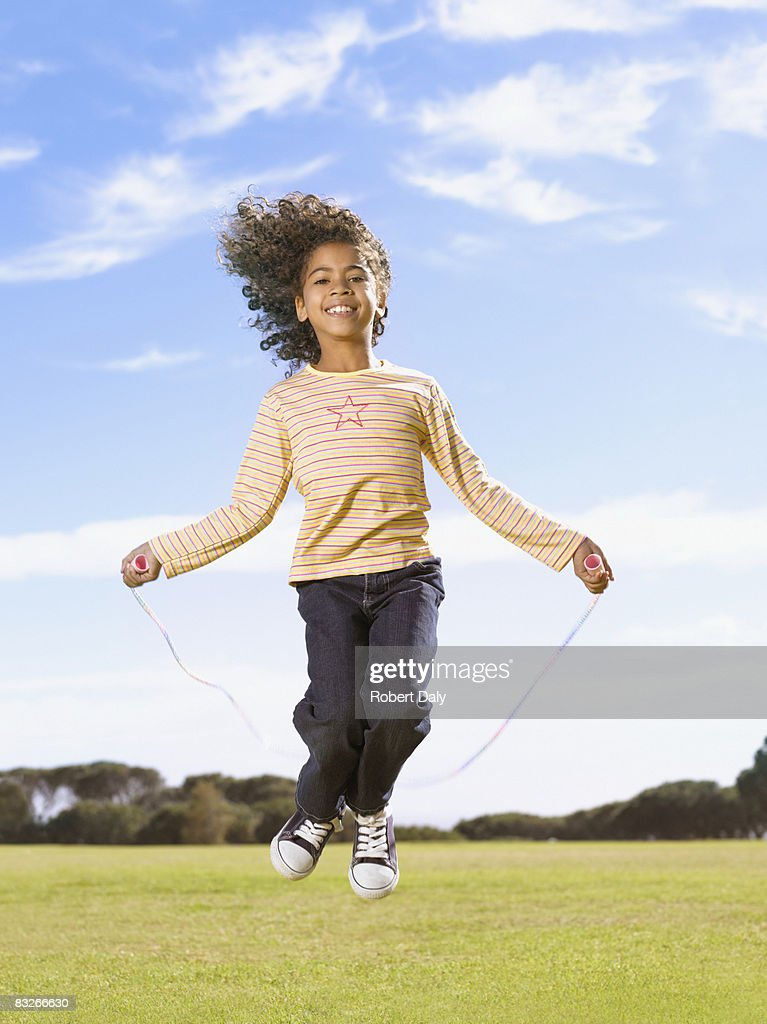 Young girl jumping rope : Stock Photo