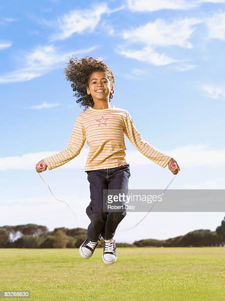 young girl jumping rope - skipping along stock photos and pictures