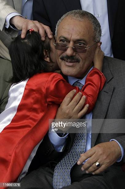 A young girl kisses Yemeni President Ali Abdullah Saleh during a Friday rally in his supporters in Sanaa on May 13 2011 where he vowed to stay on and...