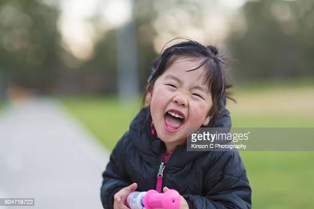 Young Girl laughing At Camera