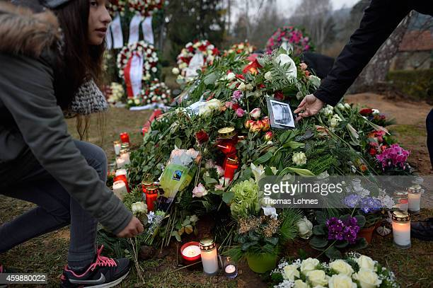 A young girl lays a candle on the grave of Tugce Albayrak the 23yearold university student who died after she was attacked in a McDonald's restaurant...
