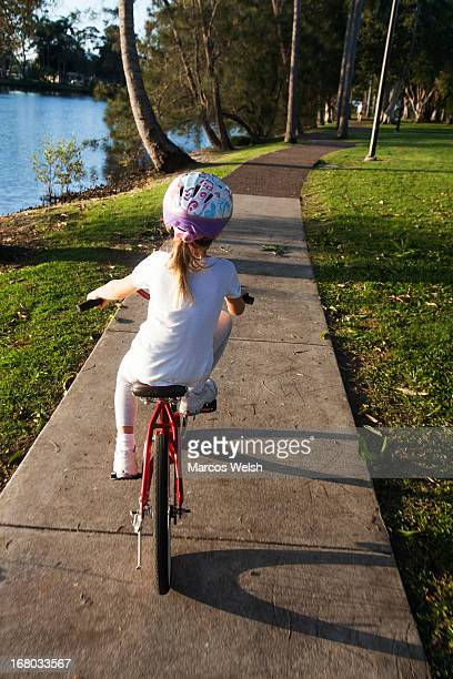 Young Girl Learning to Ride Bicycle