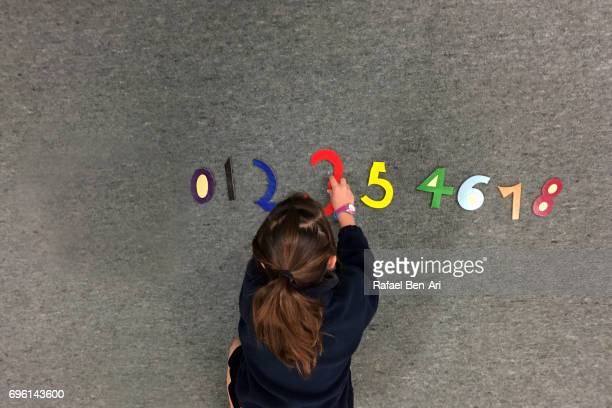 young girl learns to count numbers - rafael ben ari stock-fotos und bilder